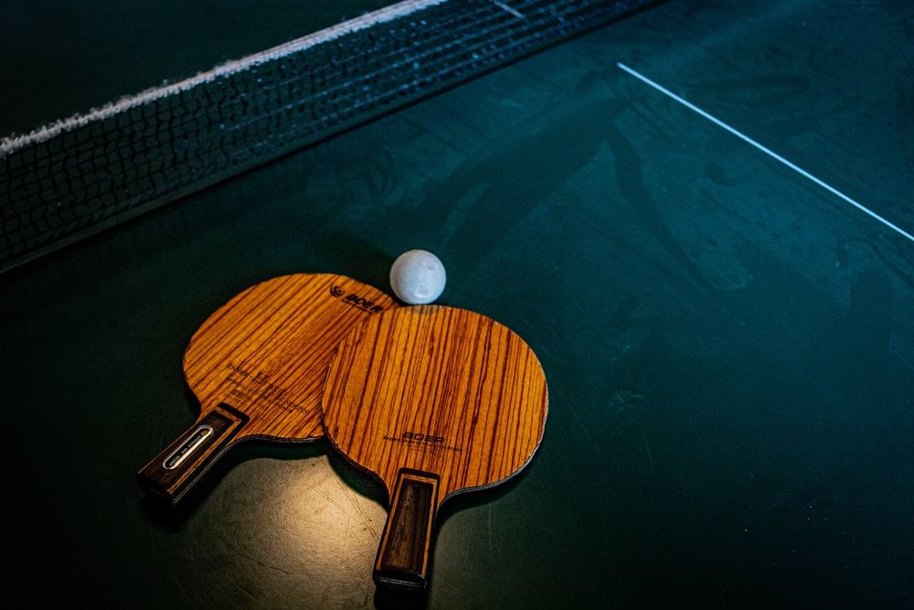 brown wooden ping-pong racket