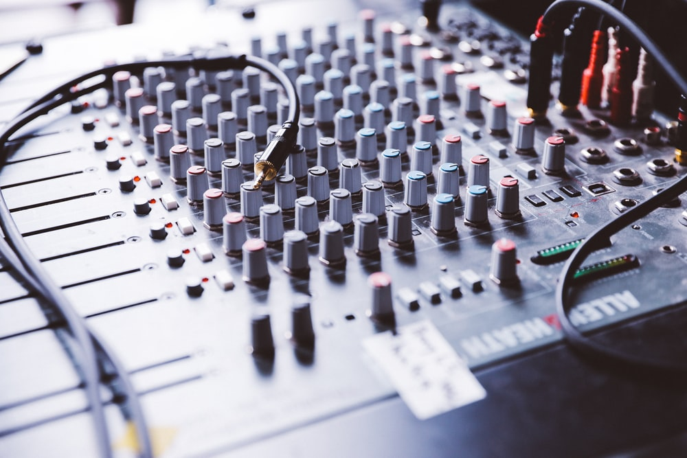 selective focus photography of gray audio mixer