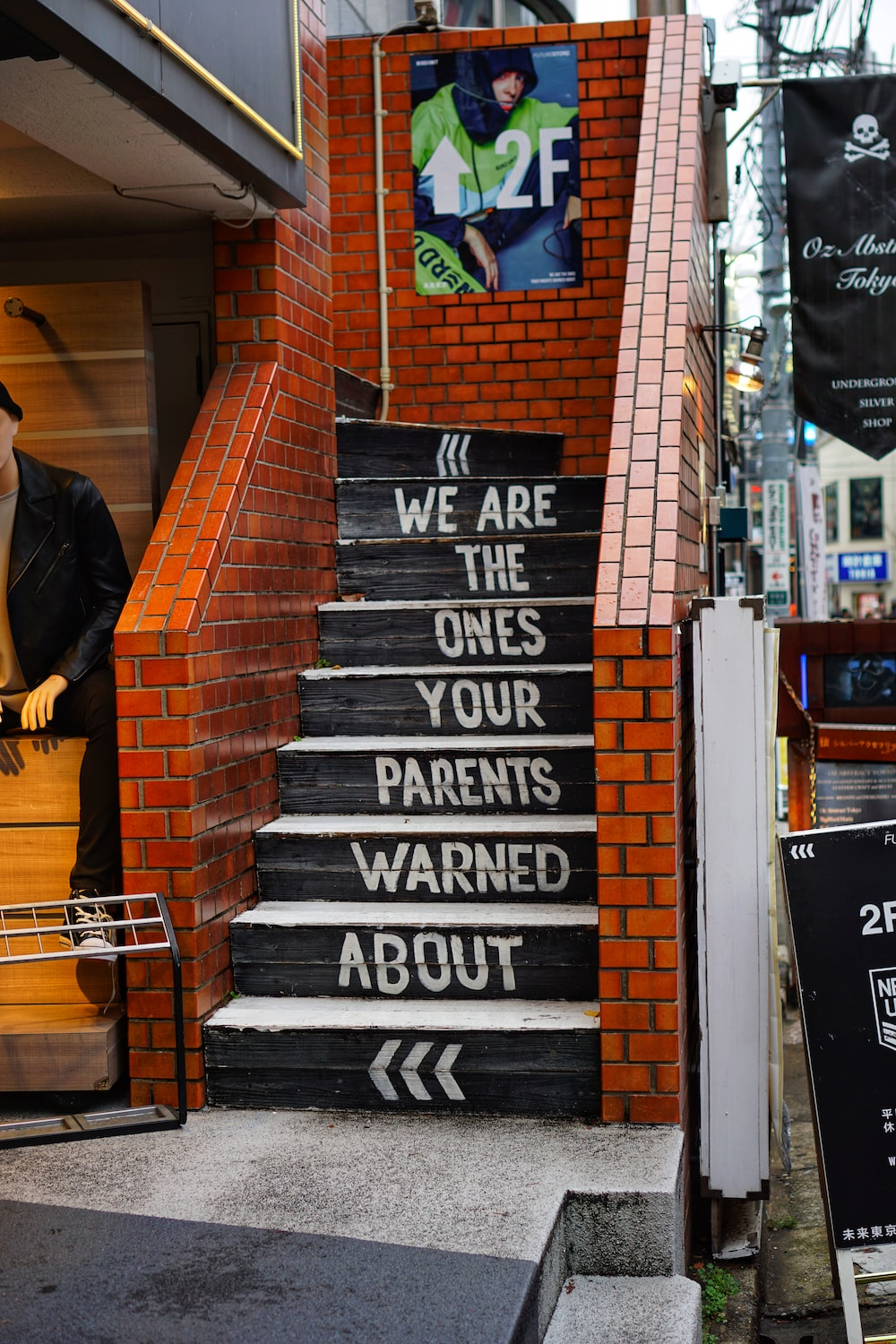 black and orange concrete stairs with we are the ones your parents warned about print