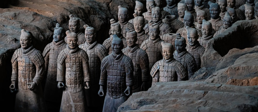 shallow focus photo of Terracotta army