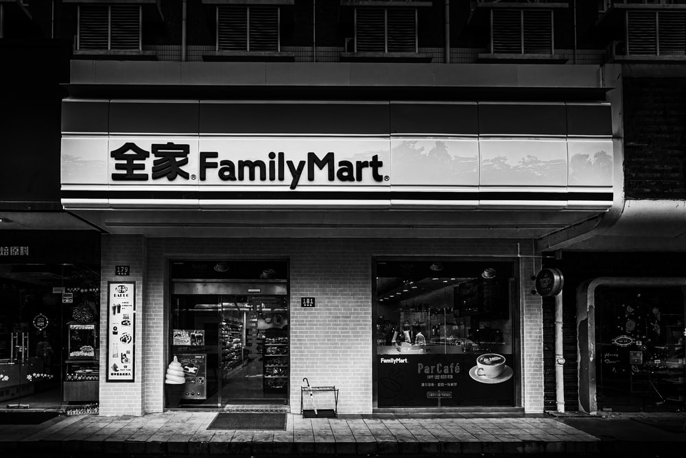 grayscale photography of family Mart building