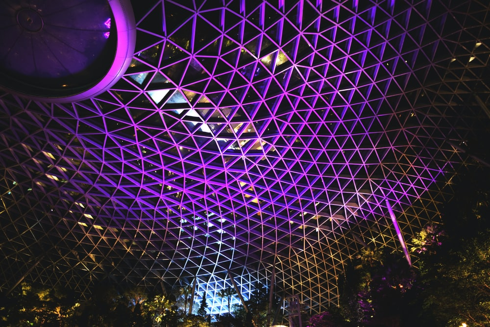 low angle photography of purple metal ceiling