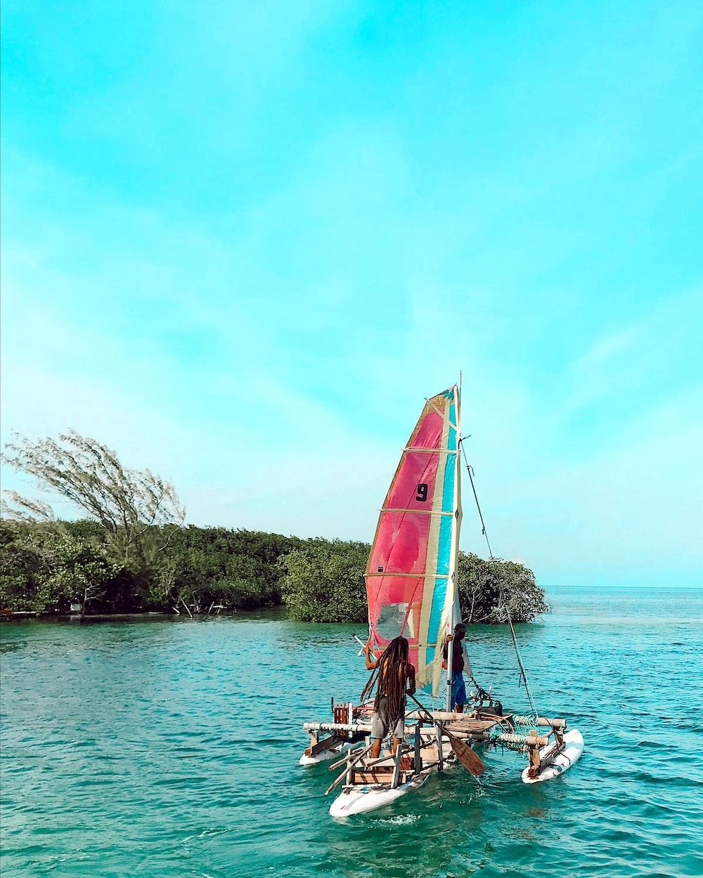 men on sailing boat