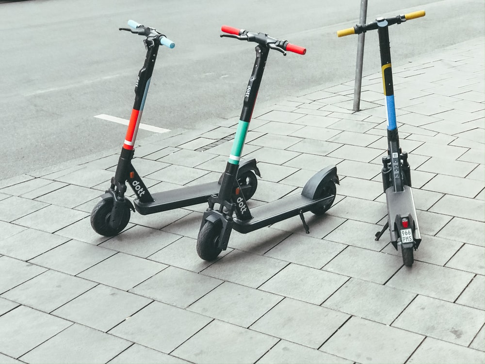 electric scooters beside street