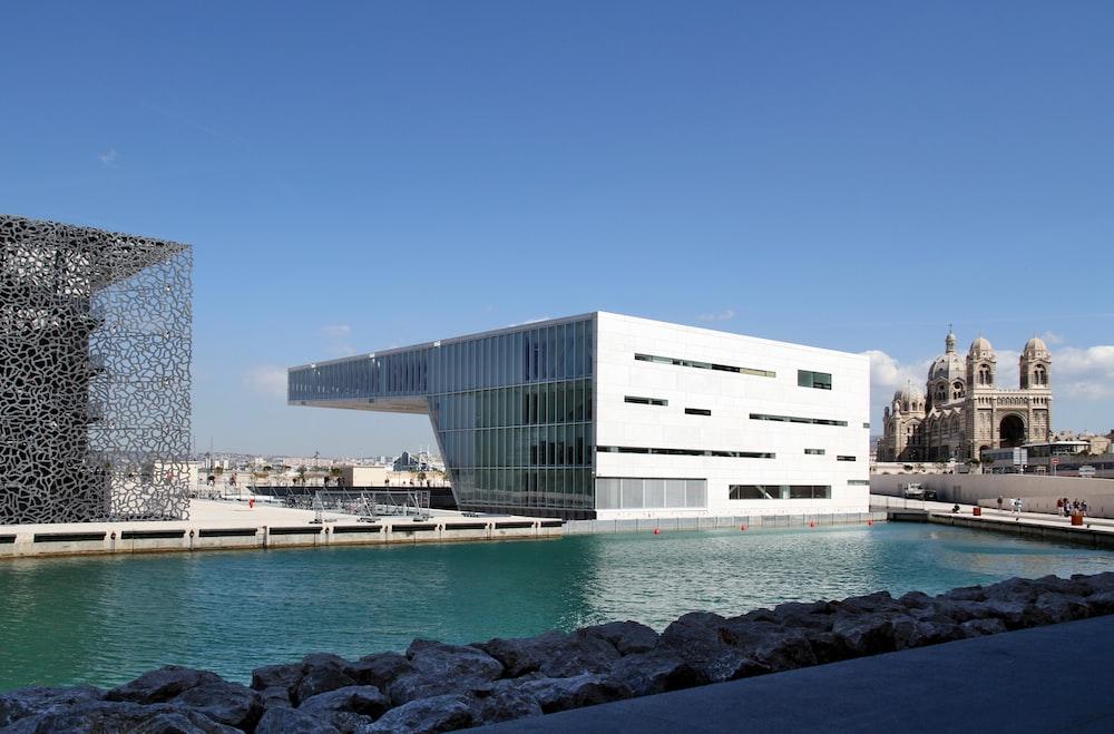 white concrete building under a calm blue sky