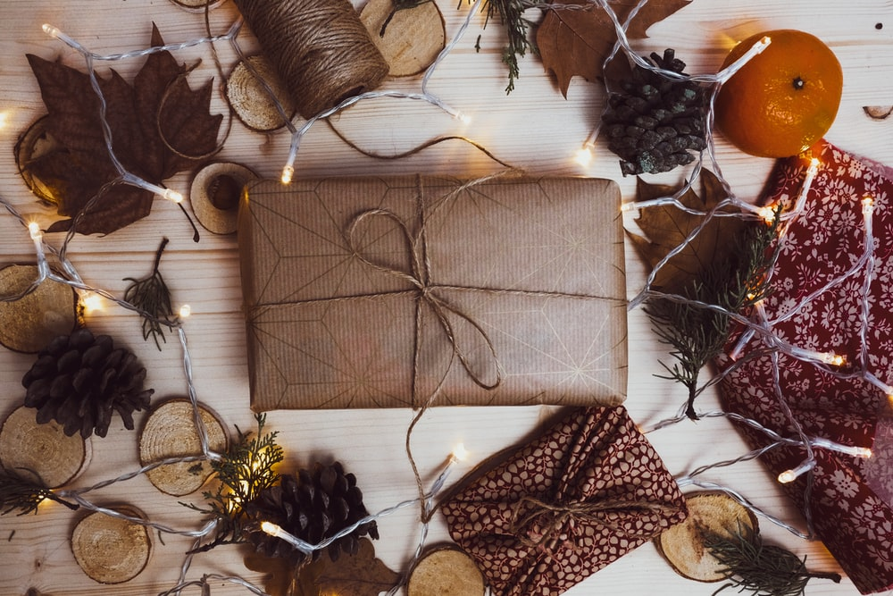 brown paper packed gift on table