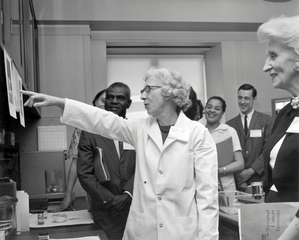 grayscale photo of doctors inside laboratory