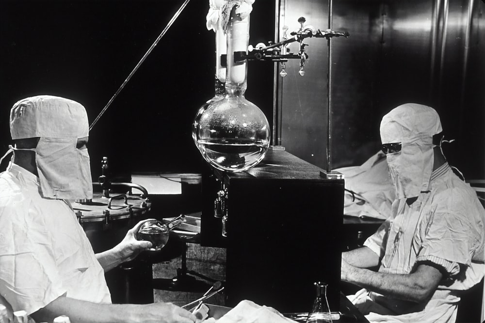 grayscale photo of people inside laboratory