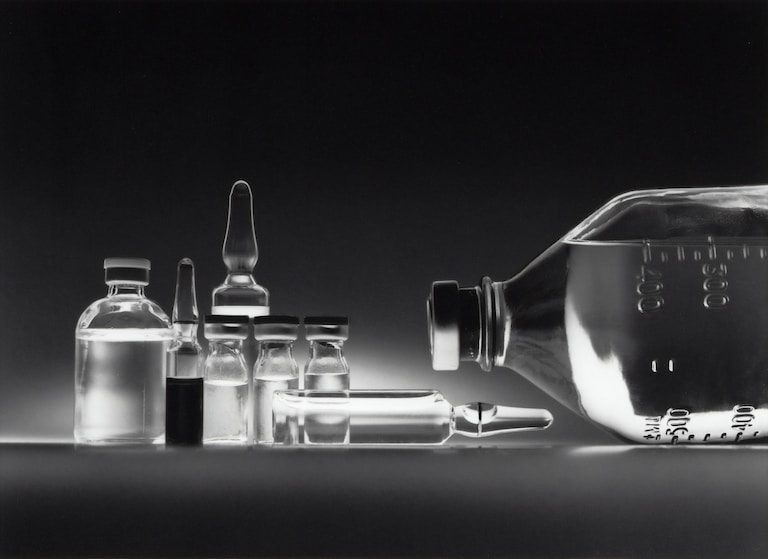 Variety of chemotherapy drugs in vials and an IV bottle.