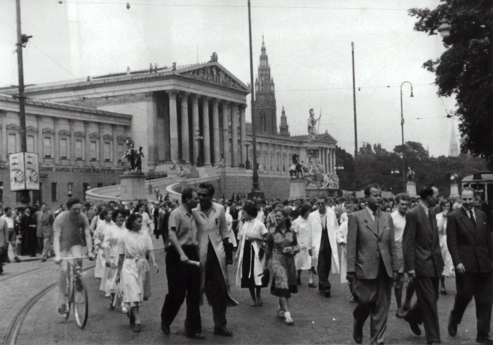 people walking on paved road
