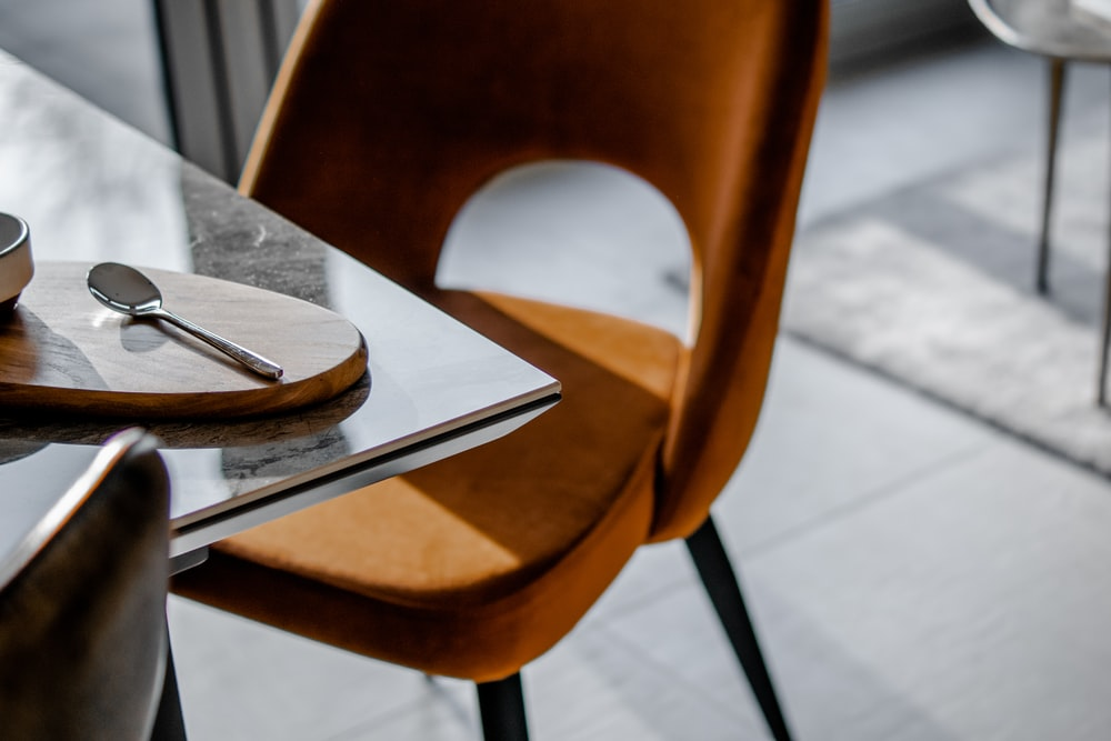 brown armless chair