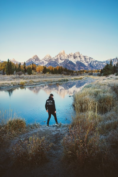 ident-ti-ty Reflections on Schwabacher Landing in Grand Teton National Park. Explore more at explorehuper.com.