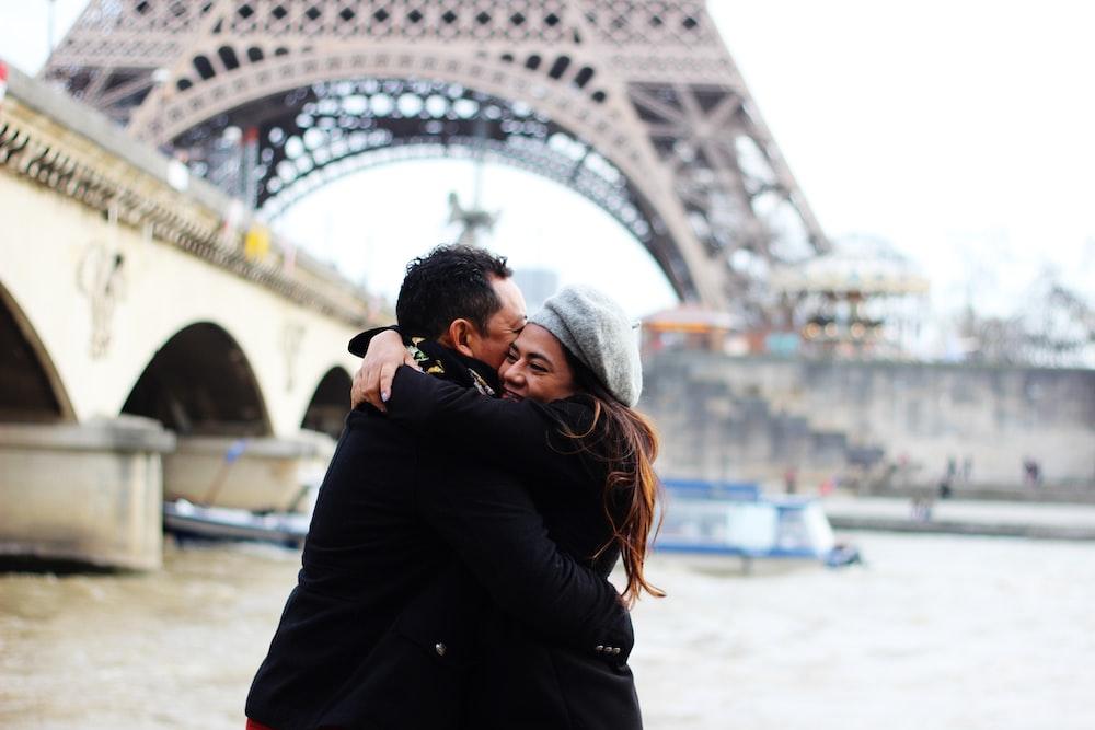 couple hugging near bridge