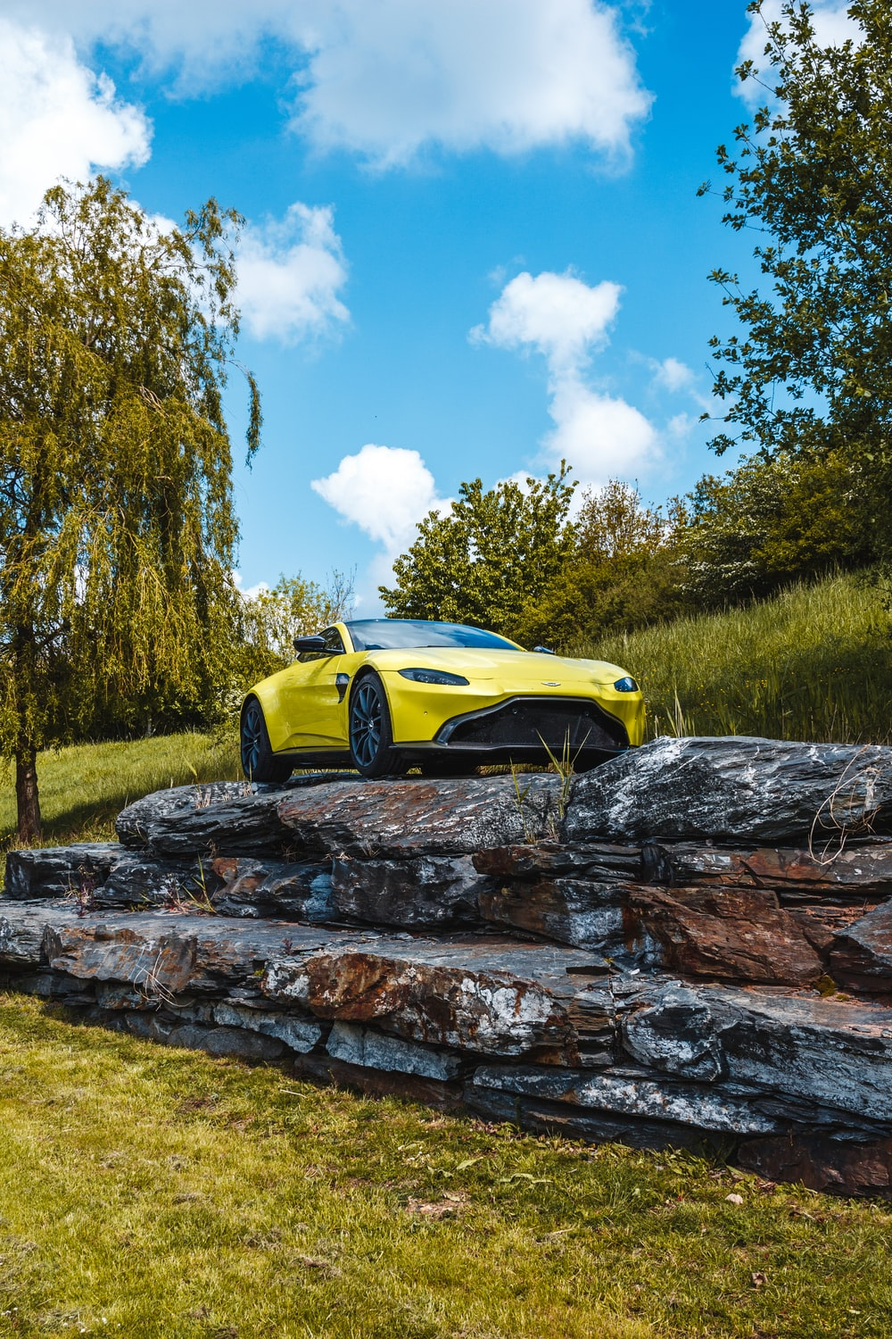 shallow focus photo of yellow coupe