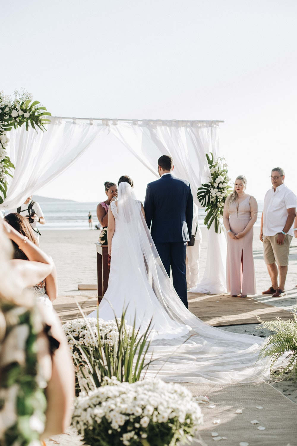 newly wed couple on isle getting married at shore