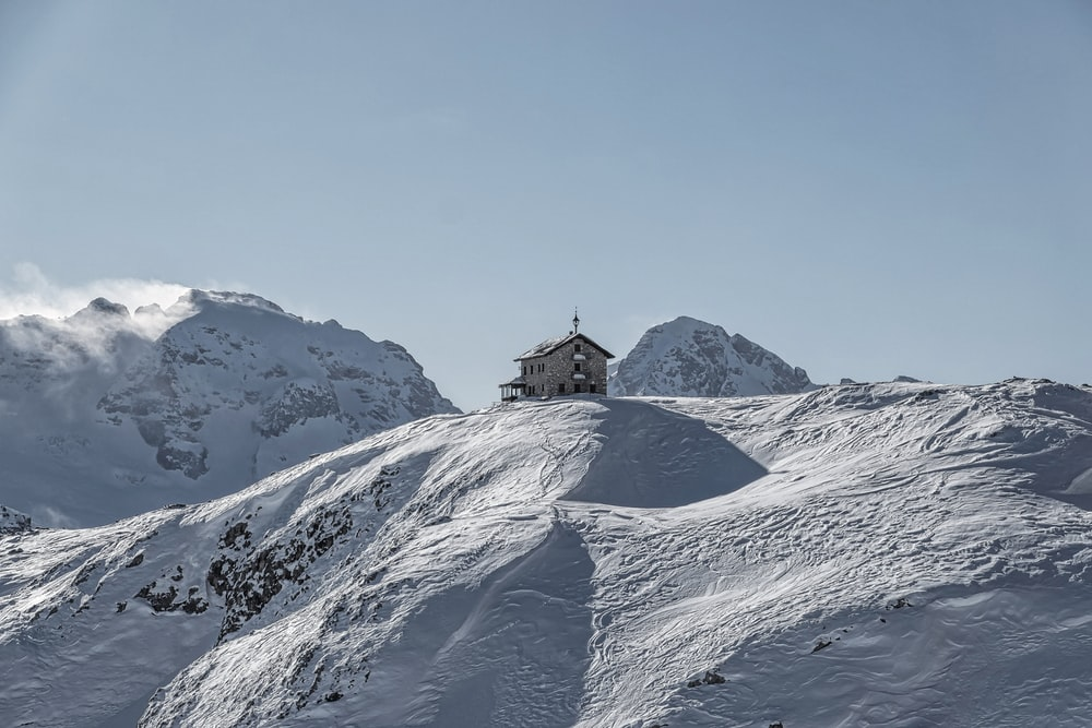 building on snow-capped mountain