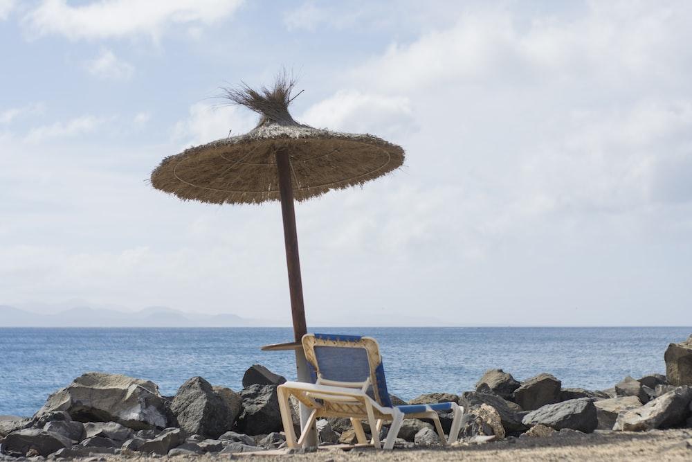 white and brown beach chair