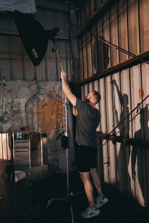 man fixing a studio lamp