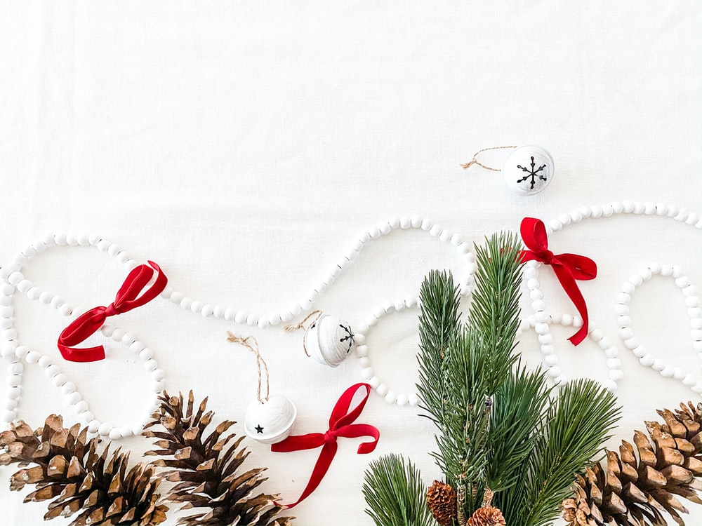 flat-lay photography of Christmas decorations in white background