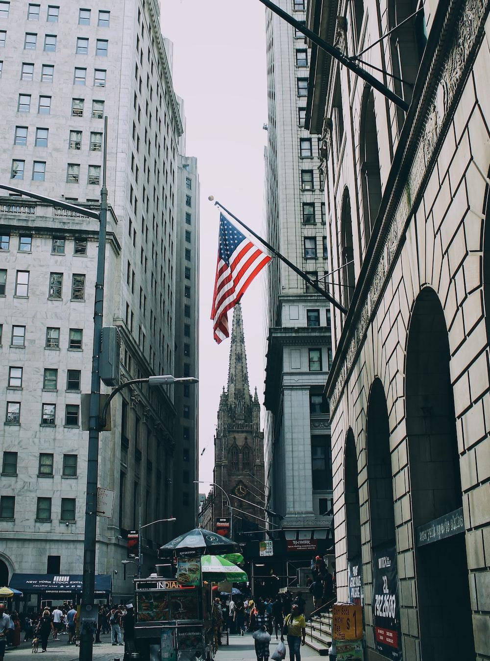 US flag beside street