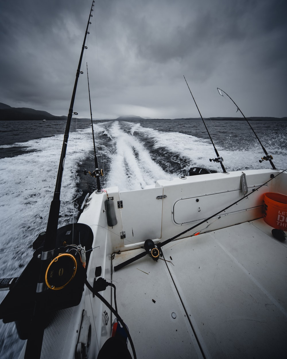 fishing rods on boat during daytime