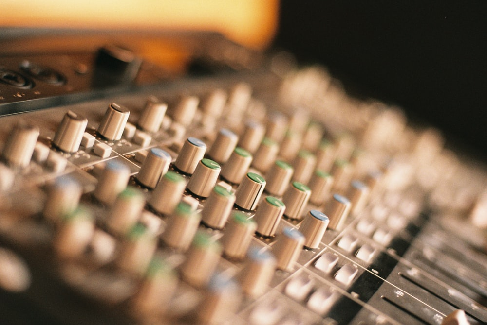 selective focus photography of music controller