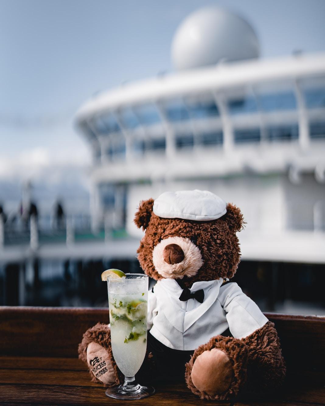 teddy bear beside the wine glass