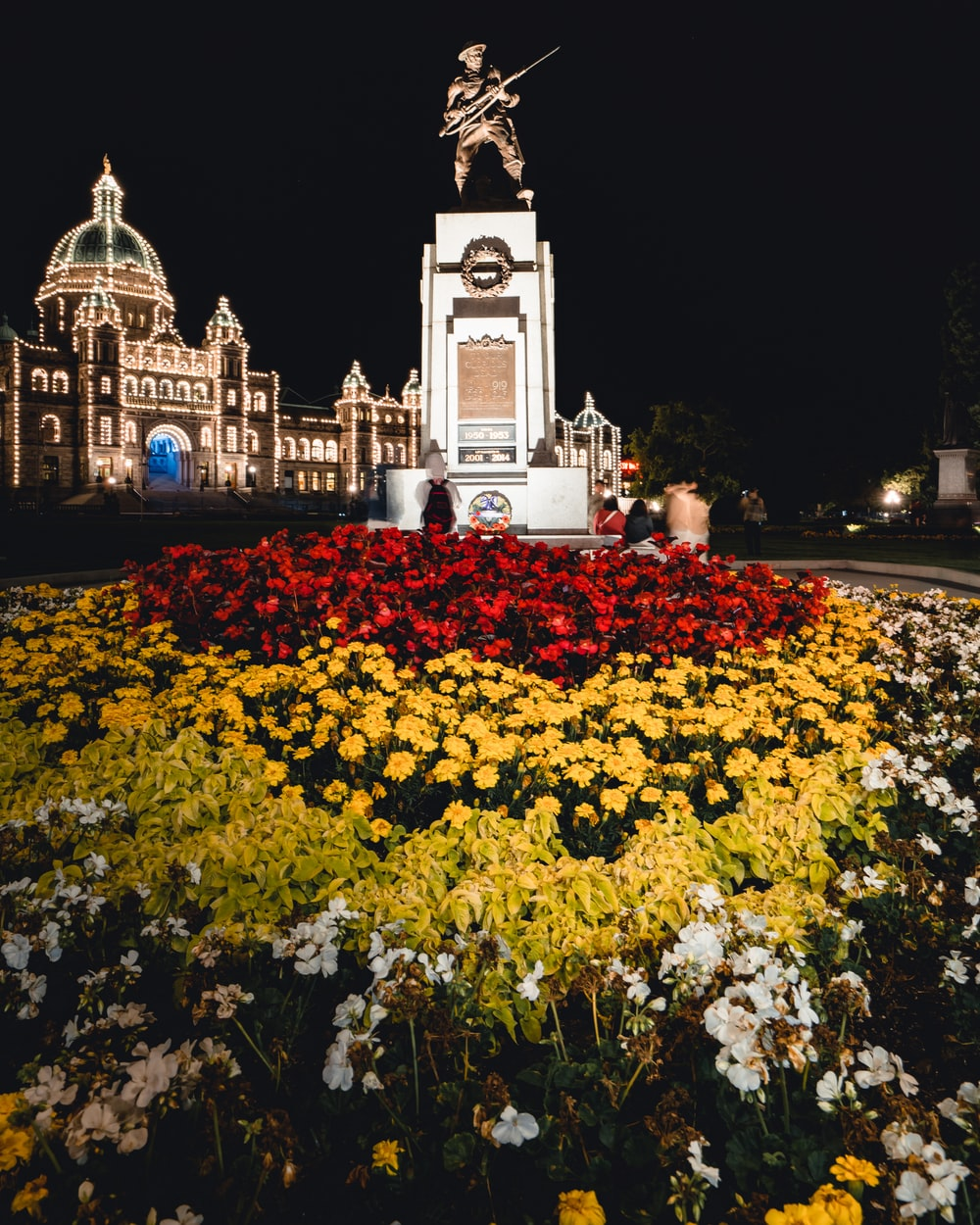 red and yellow flower field in front of the statue