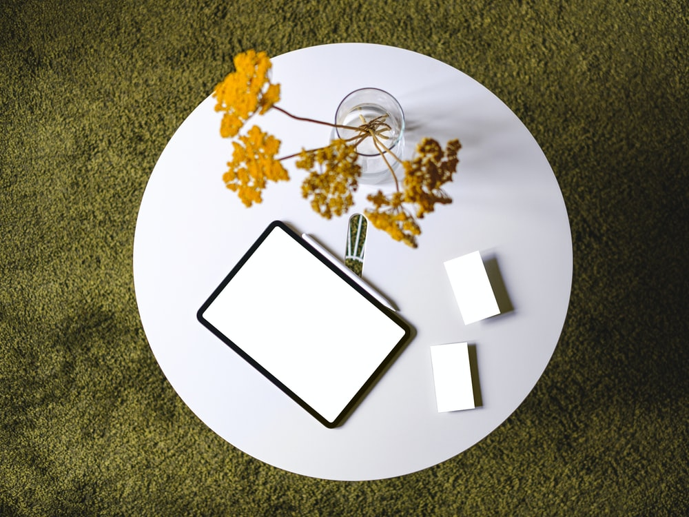 flowers and tablet on table
