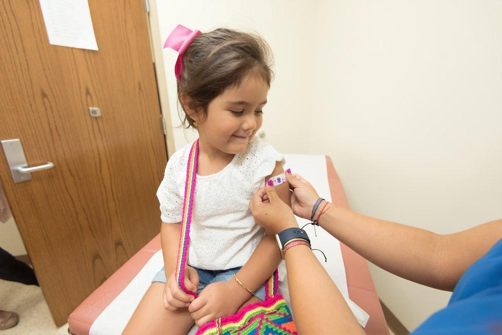 girl getting vaccine
