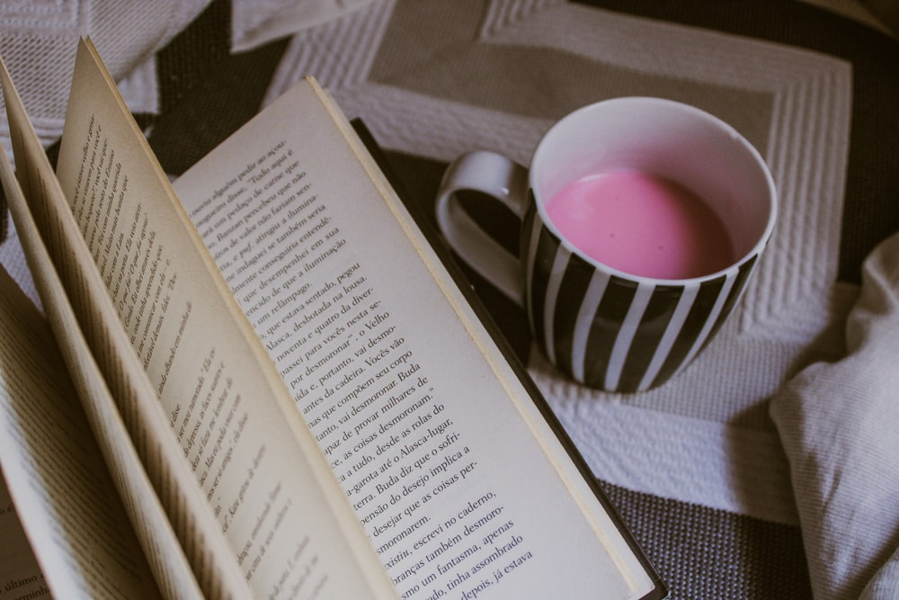 filled mug beside book