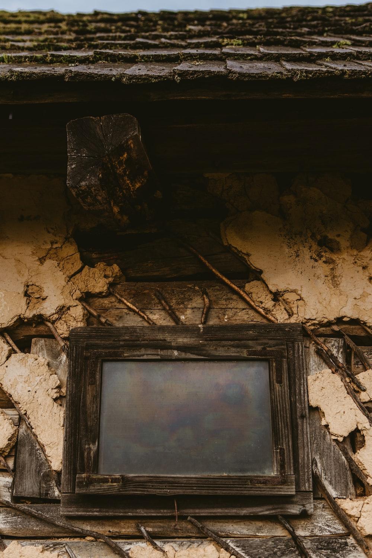 closeup photography of black wooden window
