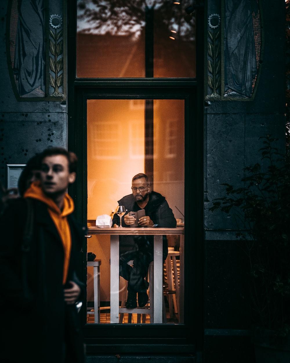 man sitting beside table