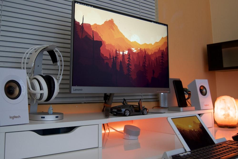 gray Lenovo flat screen TV