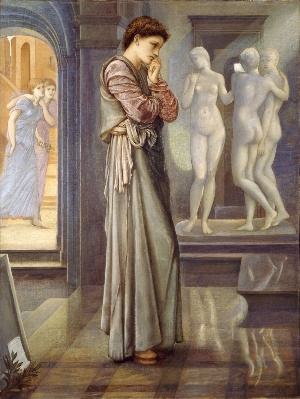 woman standing beside statues painting