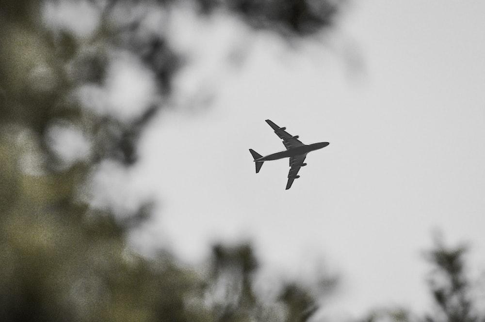 gray airliner under gray sky