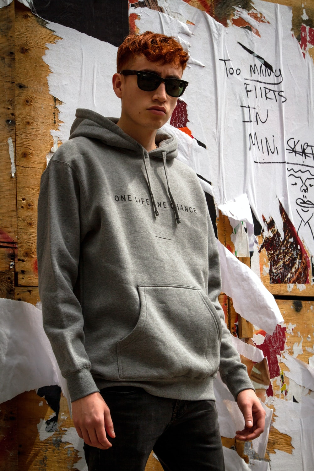 man wearing sunglasses and gray pullover hoodie