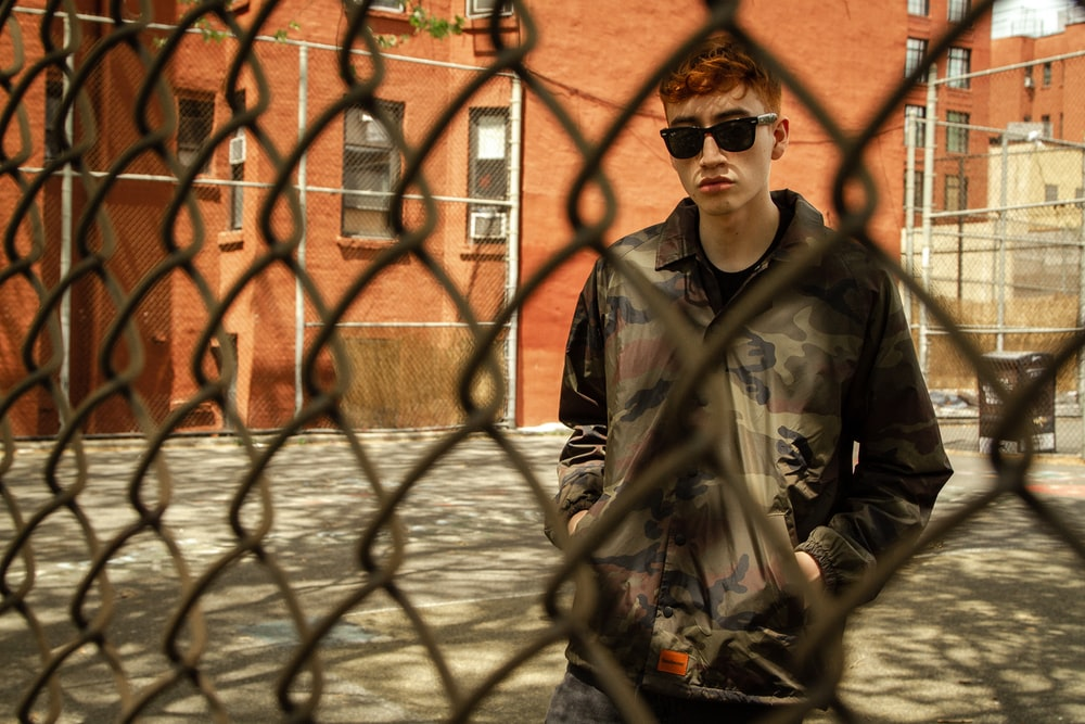 man wearing sunglasses and jacket
