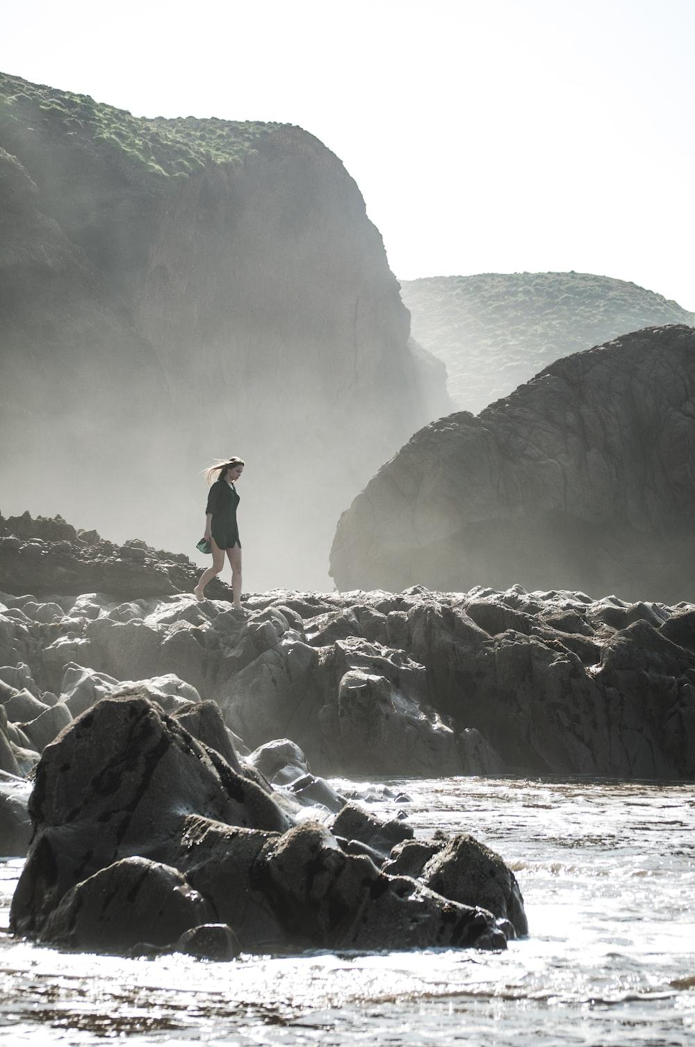 woman walking along a seawall
