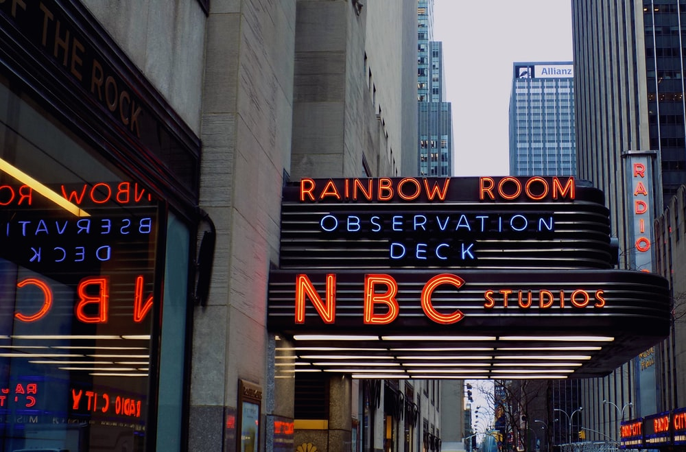 NBC Studios Rainbow Room Observation Deck signage turned on beside building at the city during day