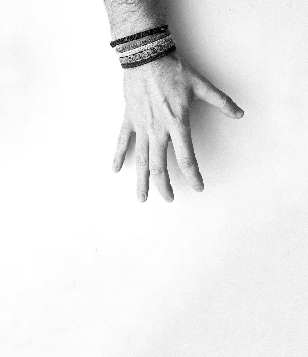 person wearing bracelets