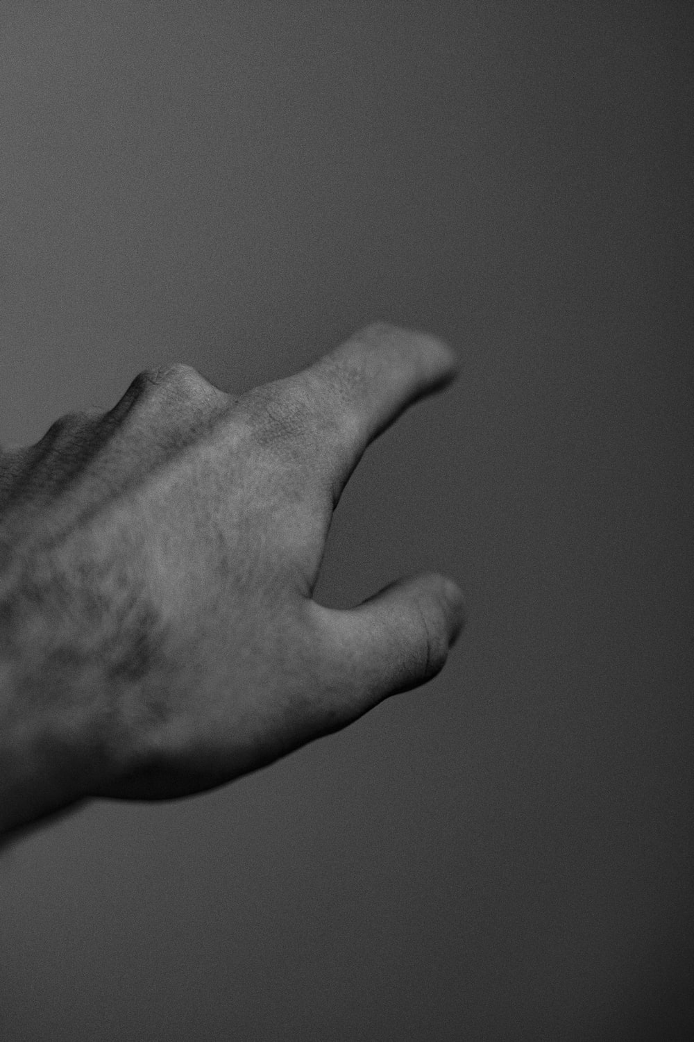 grayscale photography of pointing person