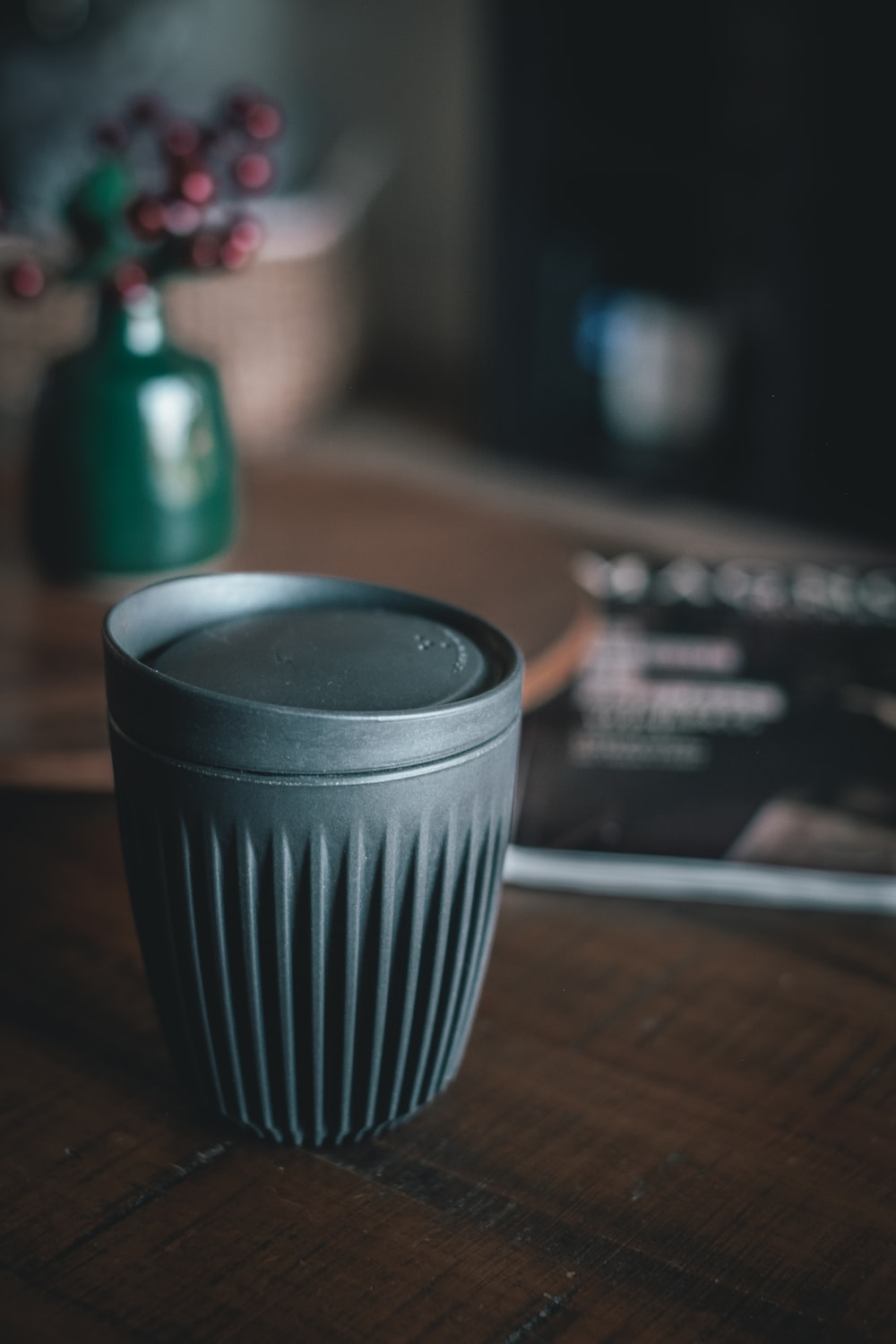 cup with lid on table