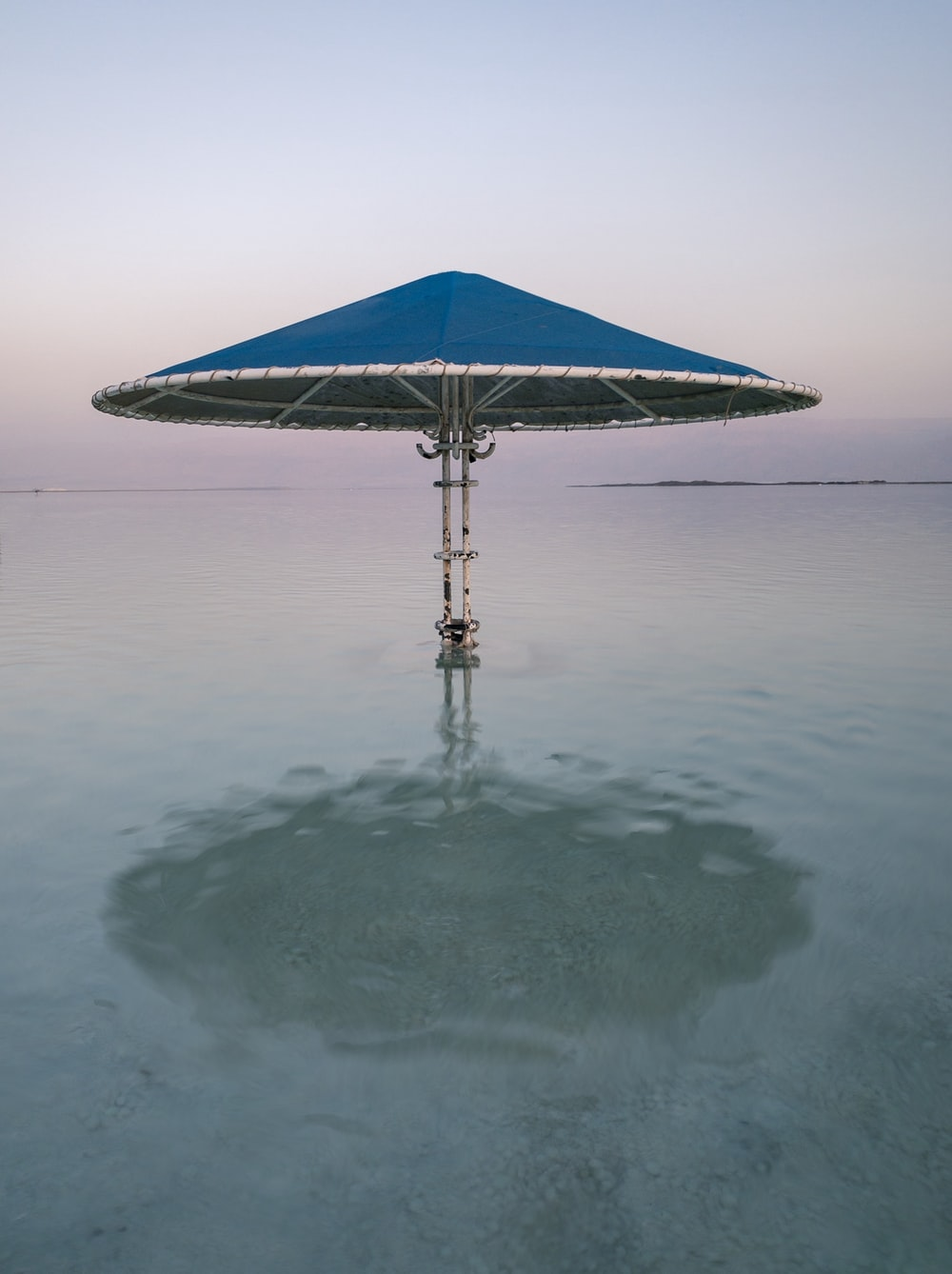 blue and gray patio umbrella in water