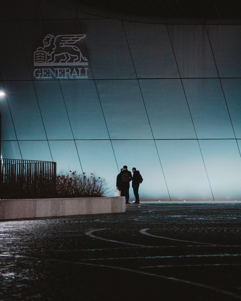 people near Generali building during night