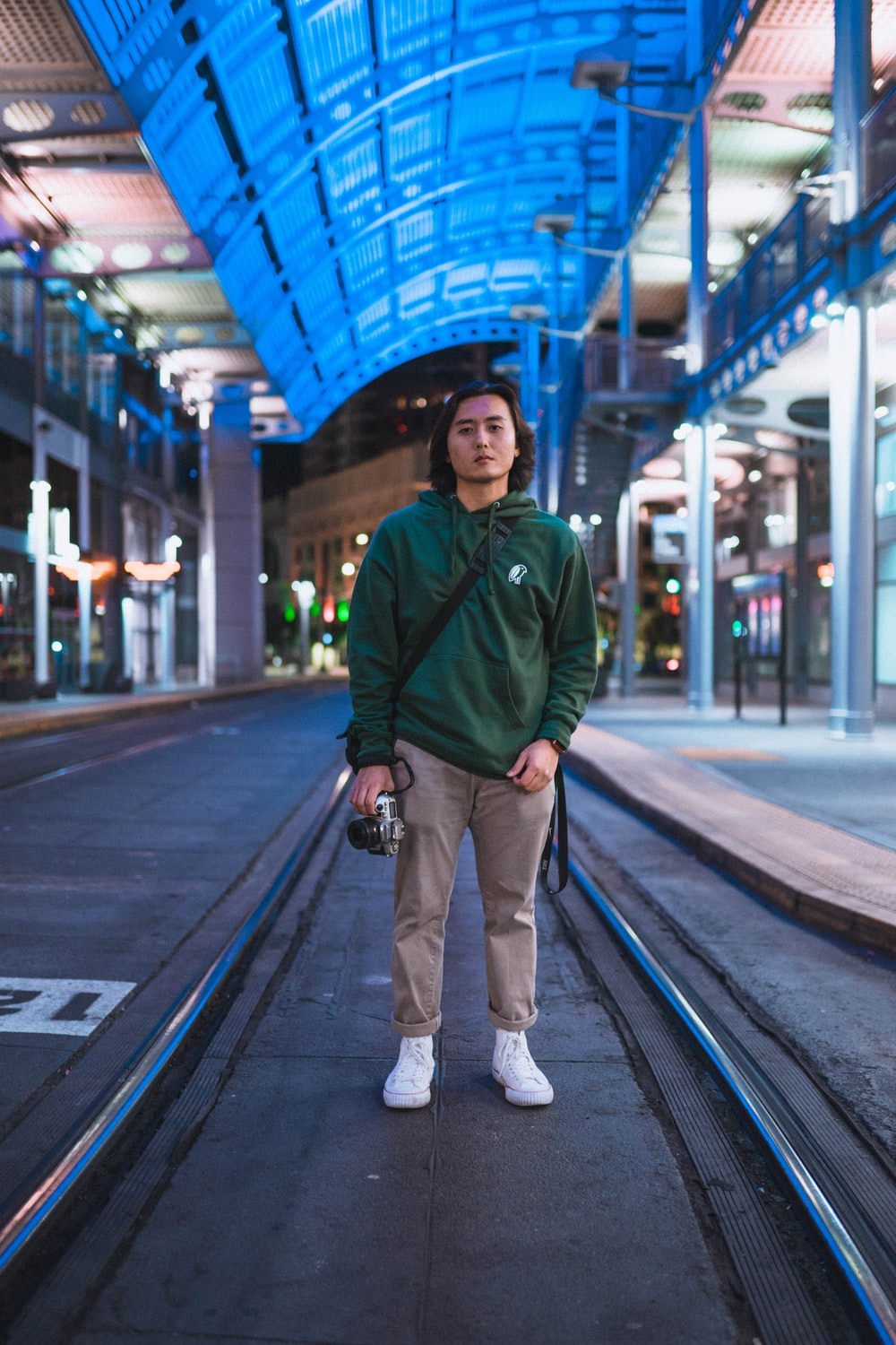 shallow focus photo of man in green pullover hoodie