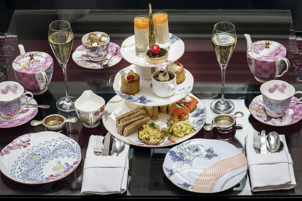assorted pastries in rack between plates