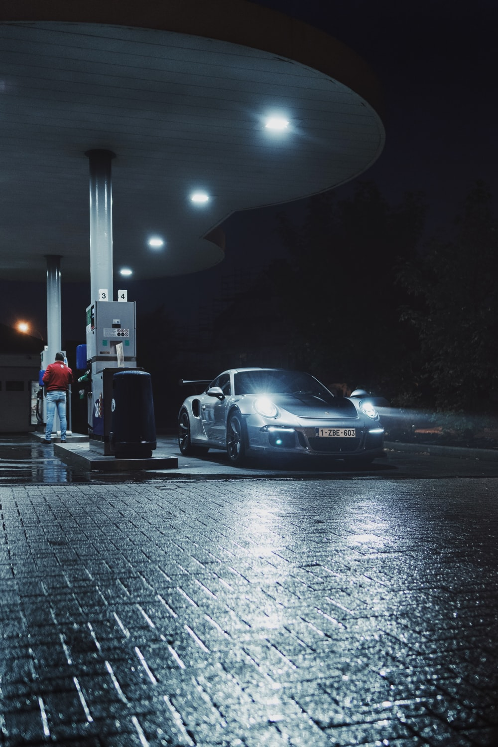 vehicle on gasoline station during nighttime