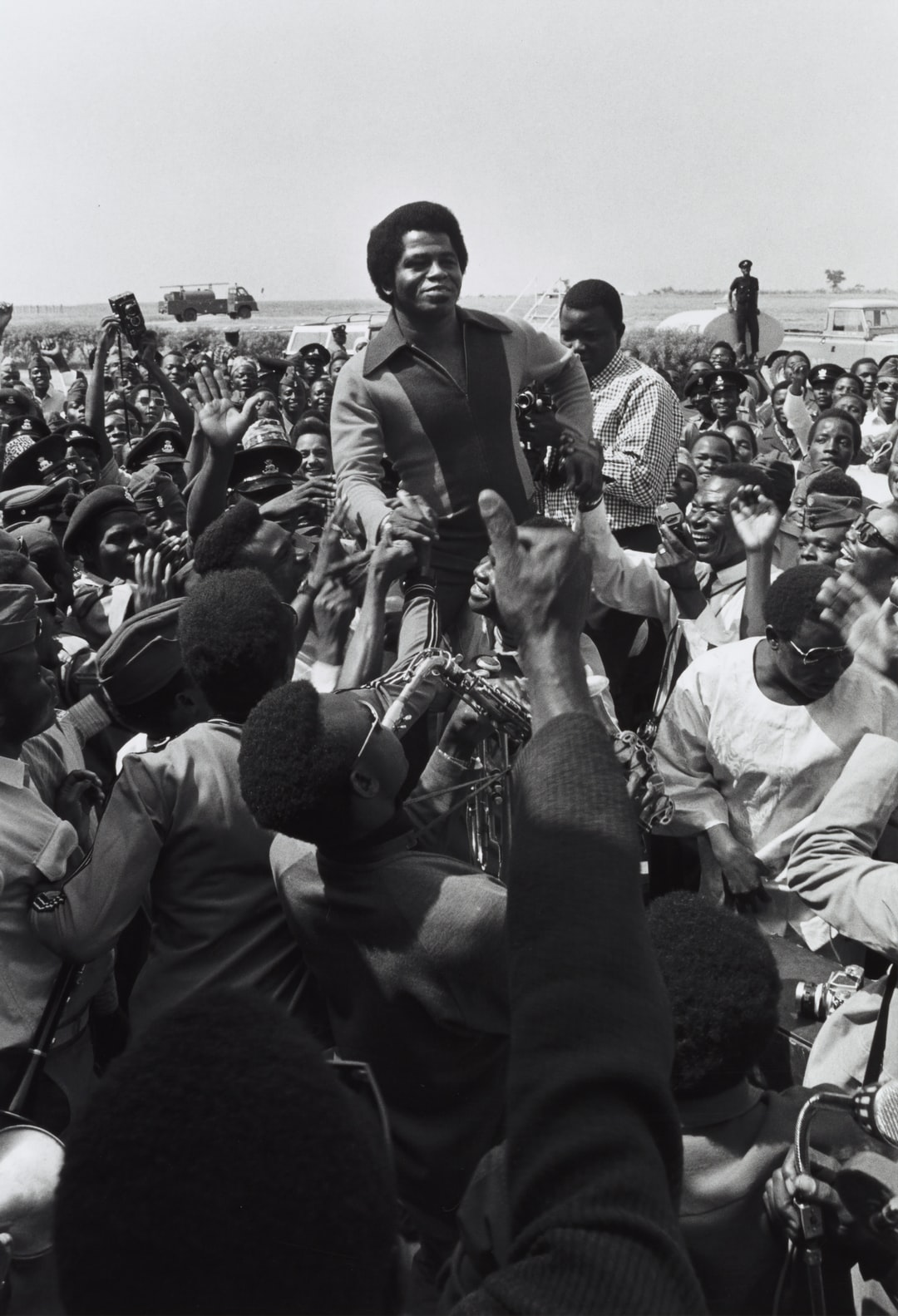 Singer James Brown being greeted by fans upon his arrival at Kaduna Airport, 1970
