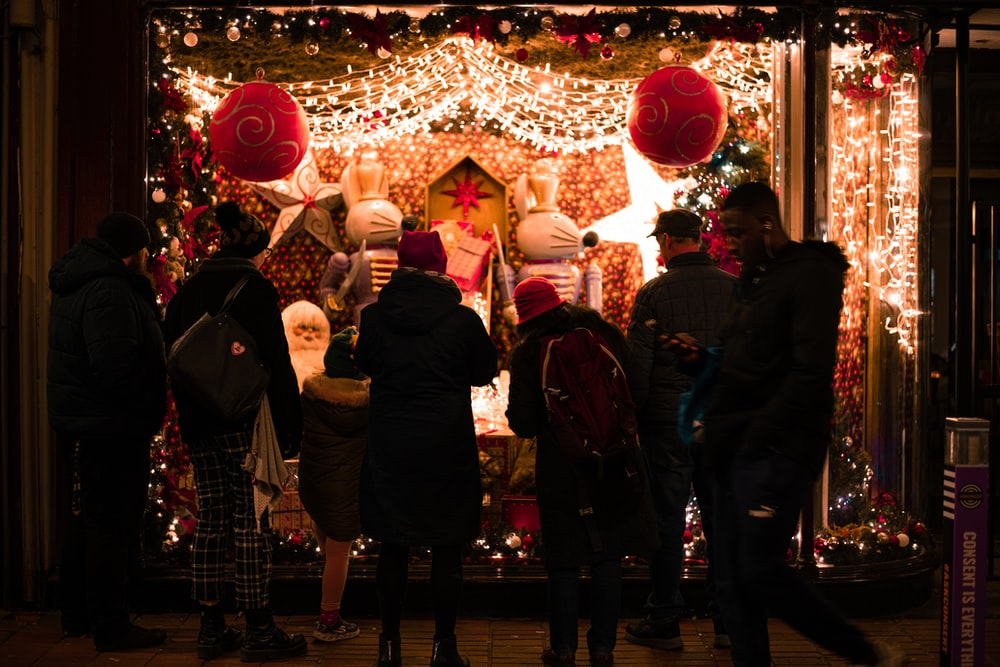 people standing and looking Christmas decors